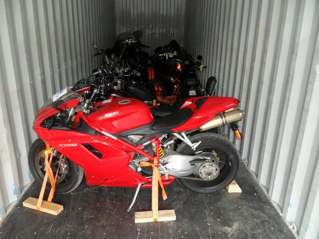 motorcycles in container